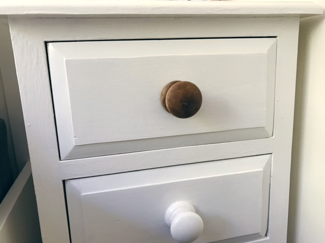 Beside drawers showing all wooden knobs