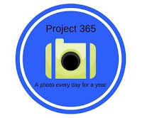 A blue circle with a camera on with the text Project 365