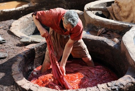 Worker in vat dyeing