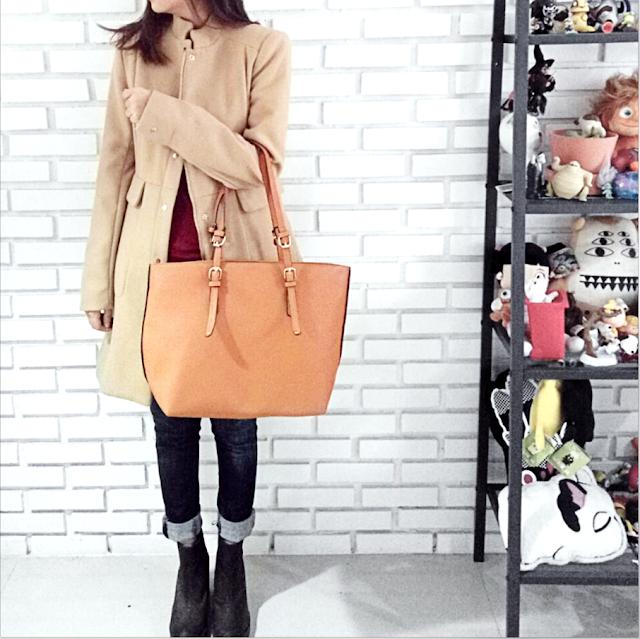 Castella Wearing Anastasia Bag