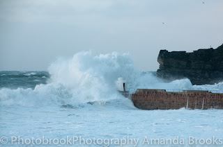Waves crashing up at Portreath beach Cornwall