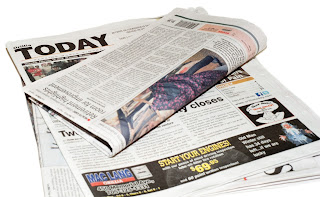 The Orillia Today newspaper with a folded newspaper on on top.