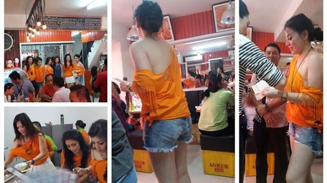 Makan Bakso Dilayanai Wanita Seksi Berbaju Oranye