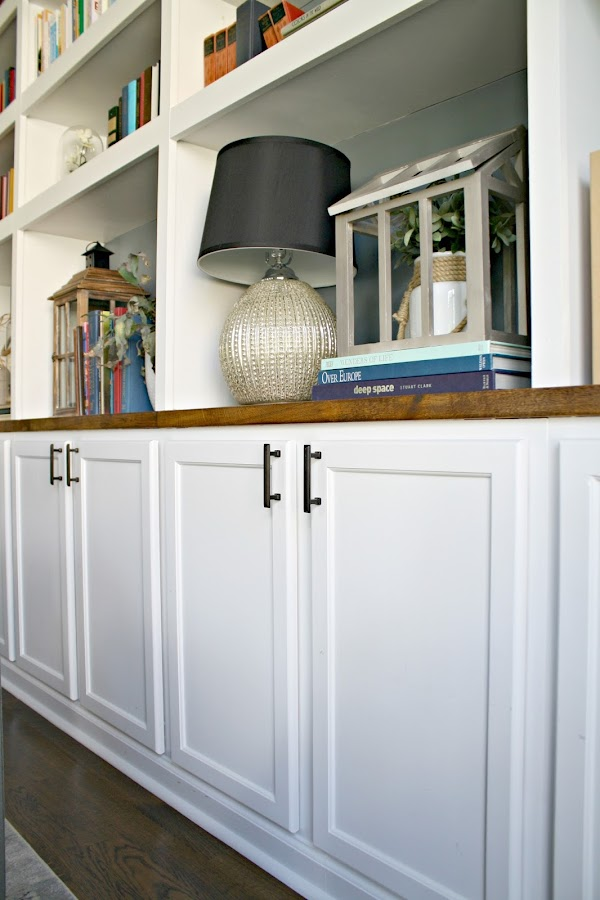 Kitchen cabinets as base to bookcases