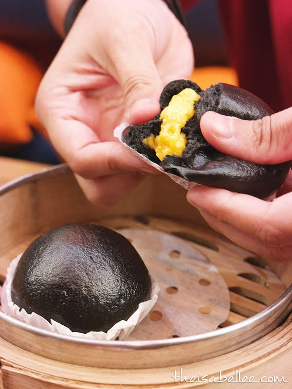 Dodo Dim Sum & Bowls charcoal custard bun with salted egg