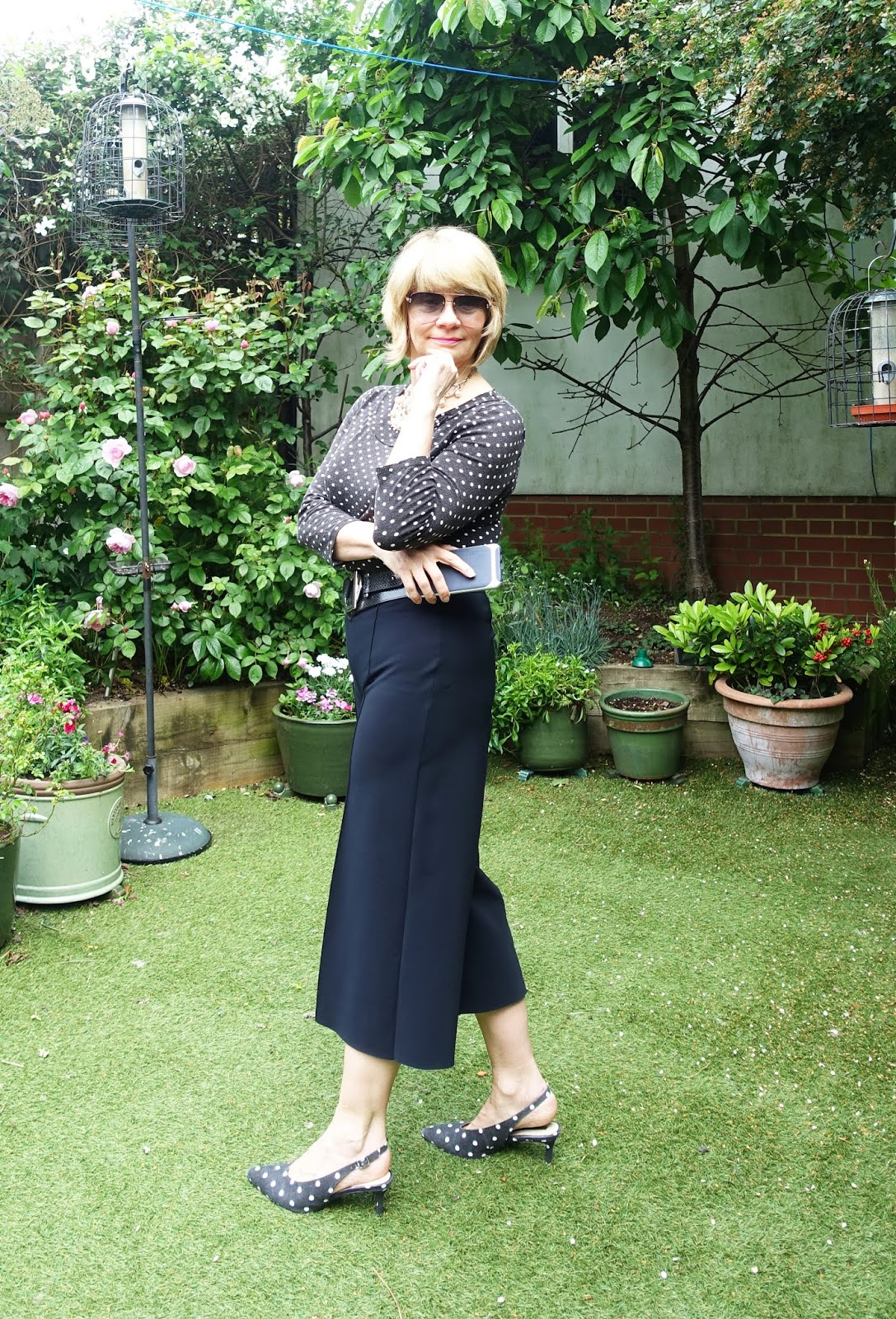 Style blog Is This Mutton? is always looking for well-cut and stylish black and white cropped trousers. This black pair from Hope is a brilliant work wear solution. Worn here with a polka dot top and matching sling back shoes.