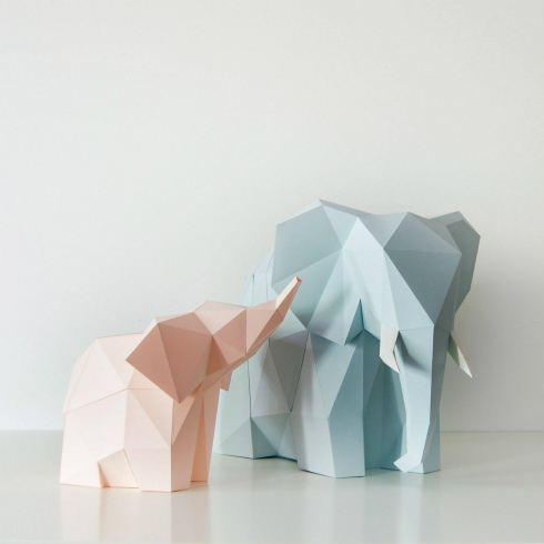 pair of blue and pink folded paper elephant lamps