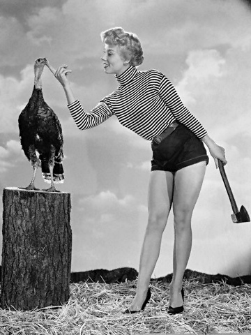 Vintage pinup image with Adelle August, turkey and axe, Hollywood ~1954