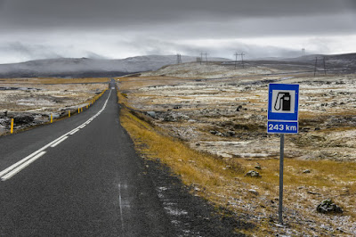 Sign on Iceland's Ring Road showing far away gas station
