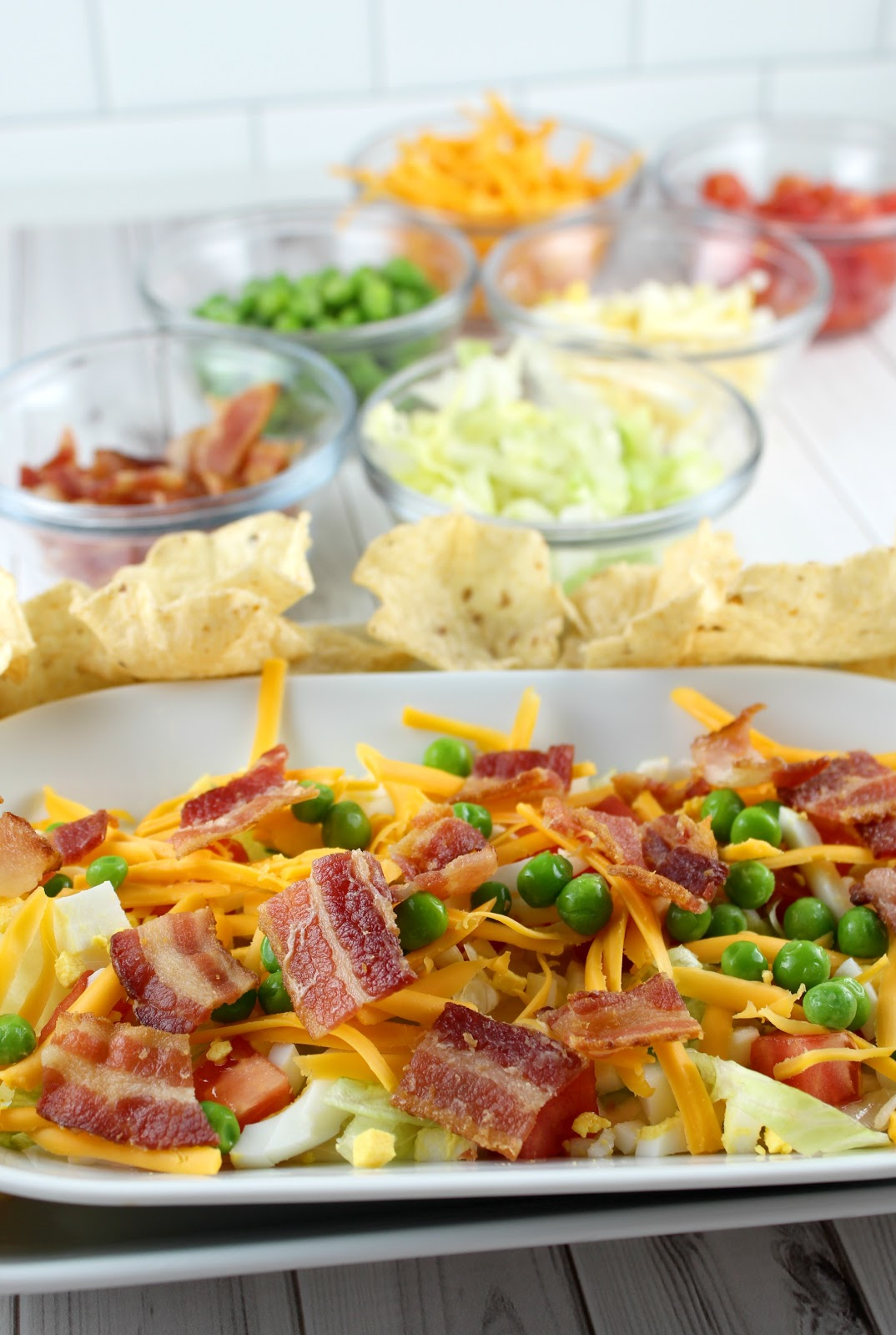 seven layer salad dip - peas, bacon, eggs, and more! make your favorite salad into a dip