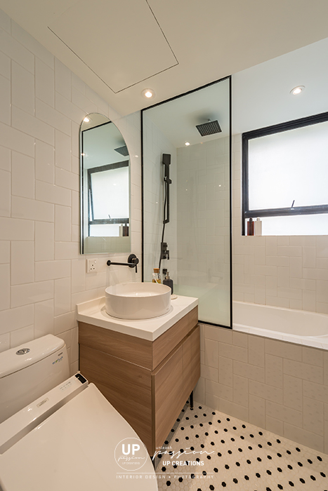 Mont Kiara Pines condo master bathroom with black and white polka dot floor tiles, shower screen with black frame, black color shower set, bath tub and bathroom vanity in wood texture