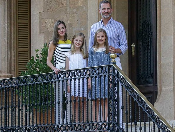 King Felipe, Queen Letizia and their daugthers Princess Leonor and Infanta Sofía on holiday in Palma de Mallorca. Letizia wore line blouse, style