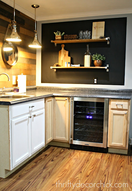 Kitchenette with wood and chalkboard walls