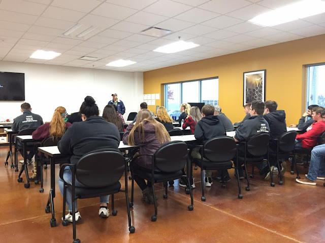 Students learning from Ferguson Enterprise
