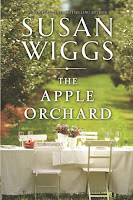 Book cover long white table in apple orchard