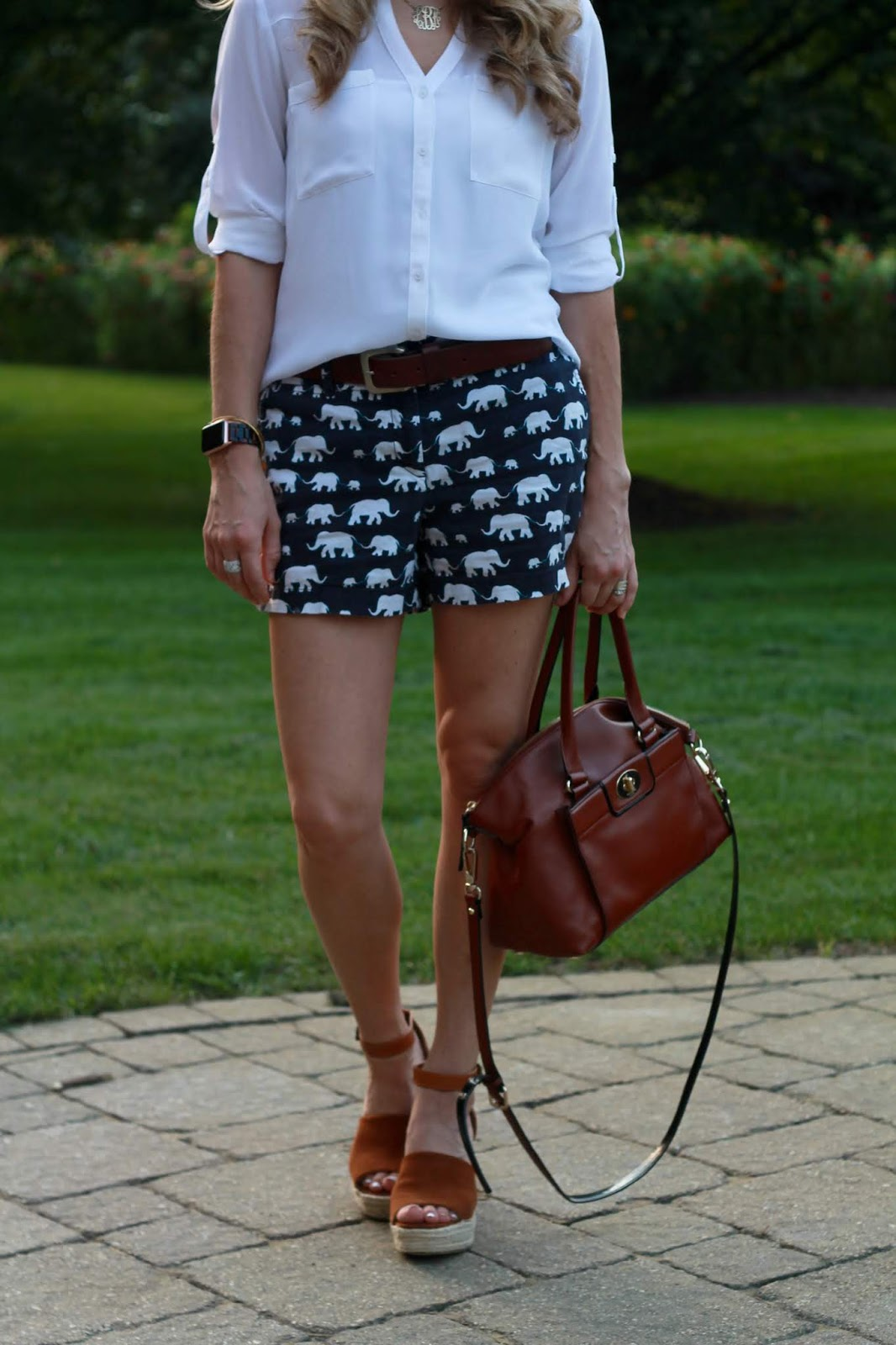 white portofino button up, elephant print shorts, cognac crossbody, gold monogram necklace