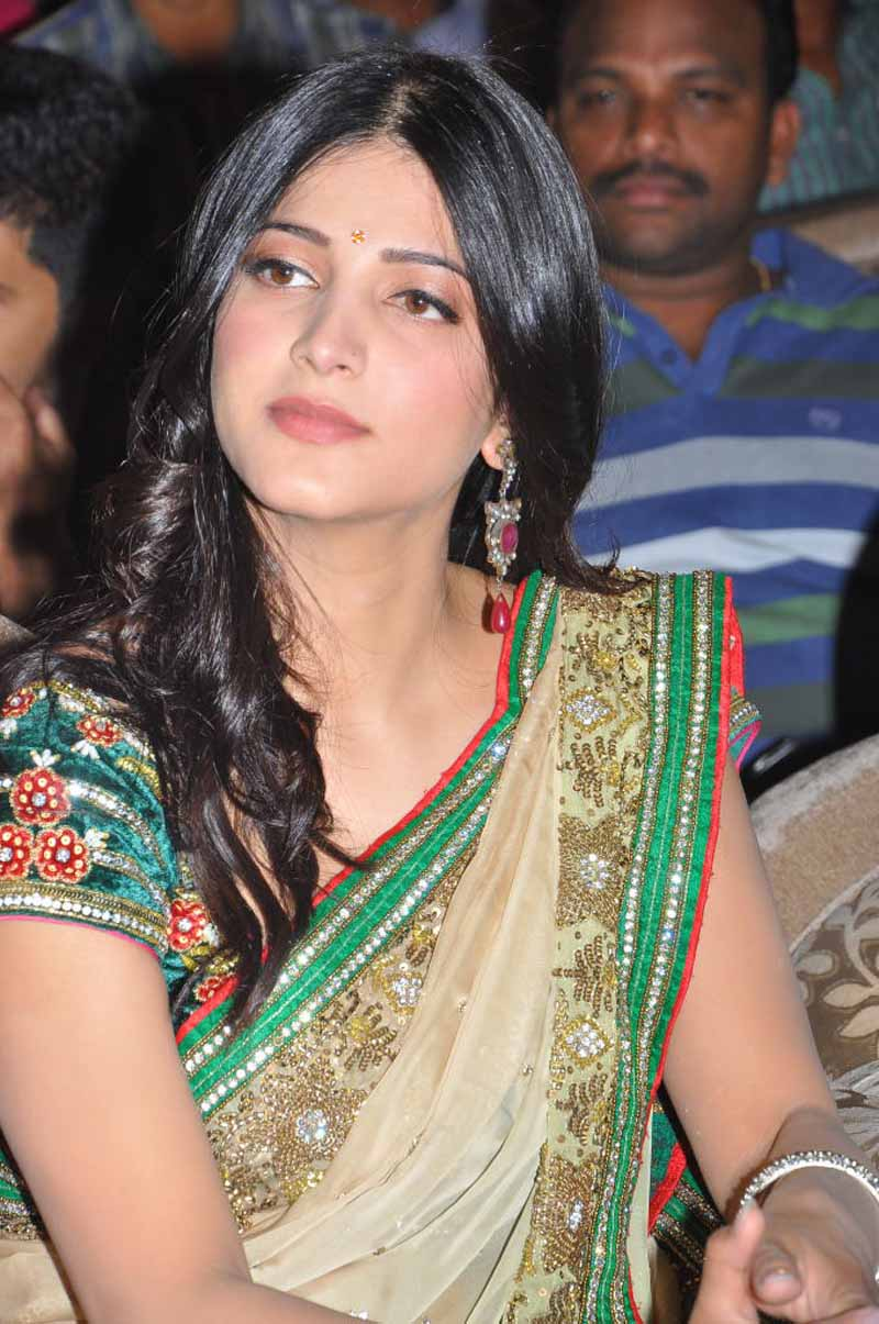 Shruti Hassan Long Hair Stills In Transparent Yellow Saree