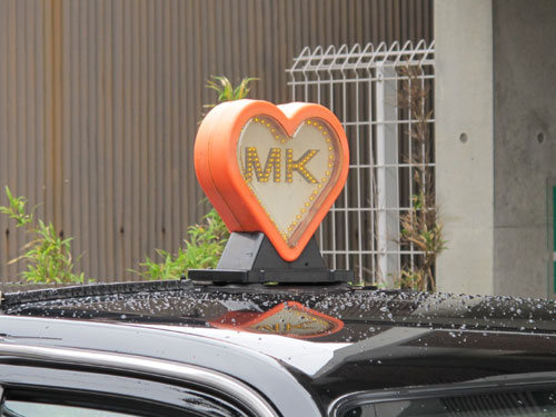 MK Taxi sign