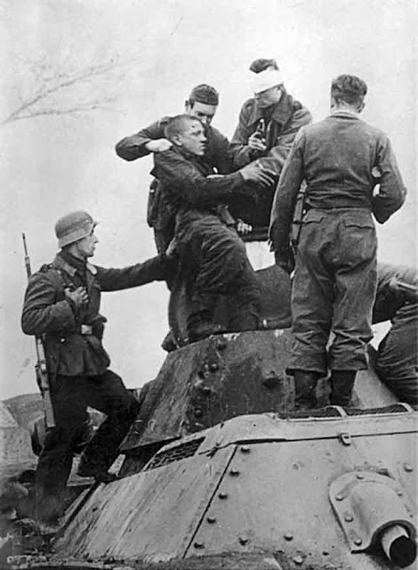 German soldiers taking crew of T-34 tank prisoner at Kalinin, 17 October 1941 worldwartwo.filminspector.com