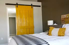 yellow painted sliding barn door