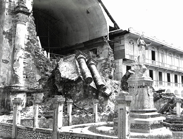 Immaculate Conception Church constructed in 1776, Batangas.  This photo shows a large block of stone that fell from the front of the church during an earthquake on 8 May 1942.  Taken 23 May 1945.