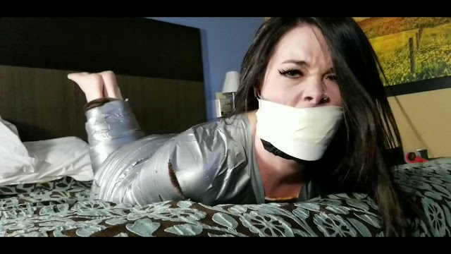 Jasmin Jai trying to escape out of tape mummification bondage