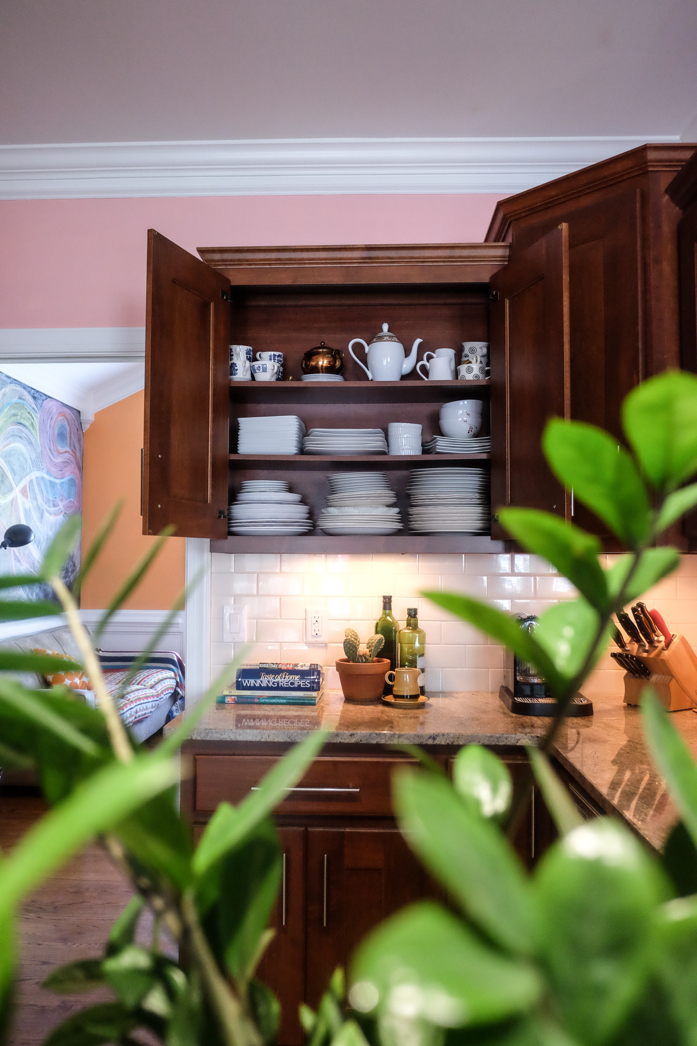 Greenery and plate collection in kitchen-designaddictmom