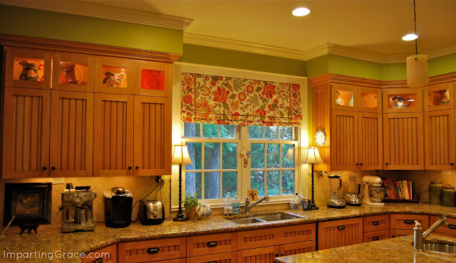 A tablecloth is a great source for wide fabric to create a faux Roman shade for a wide window.