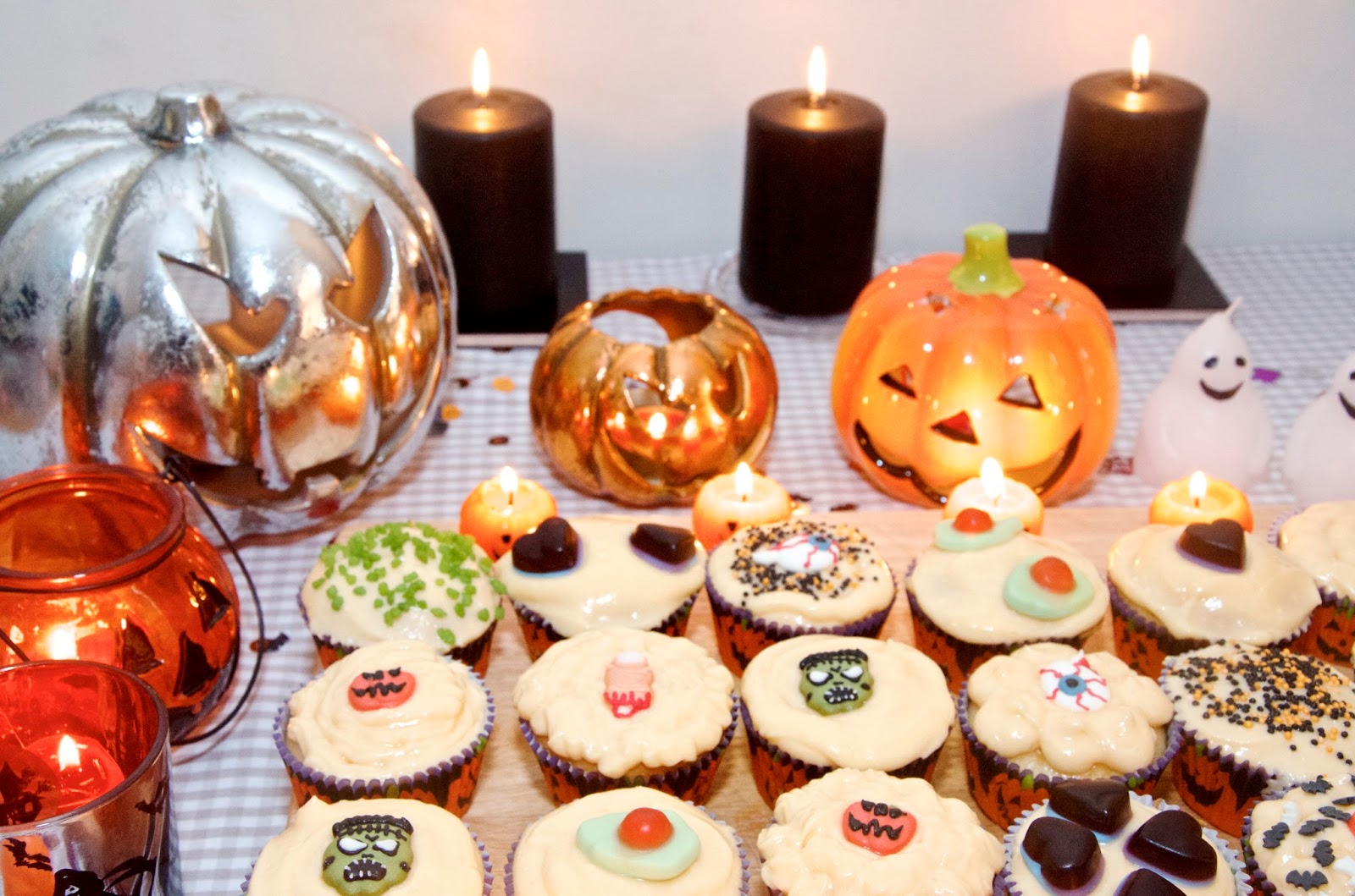 jack-o-lanterns, black candles and fairy cakes
