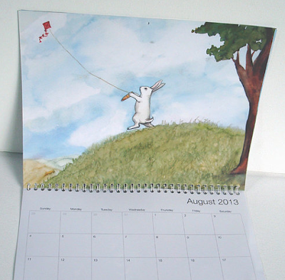 2013 calendar with rabbits - page shown is bunny flying a kite