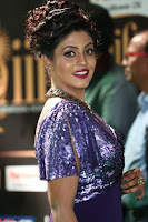 Iniya in a deep neck gown super cute beauty at IIFA Utsavam Awards press meet 27th March 2017 005.JPG