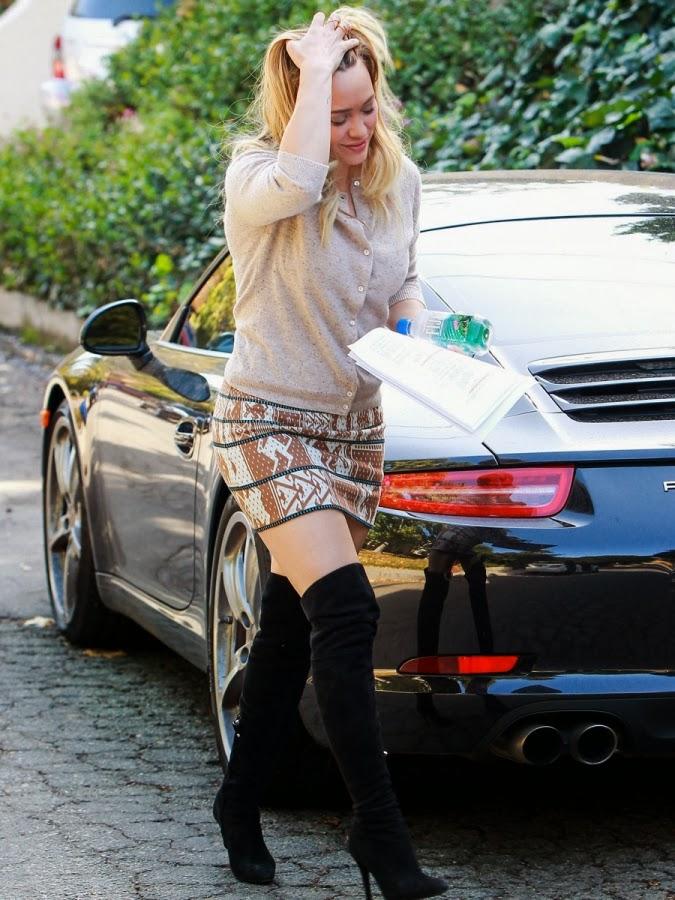 b2370b6dd2cd5b Hilary Duff  s Beverly Hills in a  338 Suno Animal Jacquard Skirt and  275 Sam  Edelman Kayla Boots.