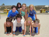 Campers make a human pyramid on the beach at Aloha Summer Camp in Malibu