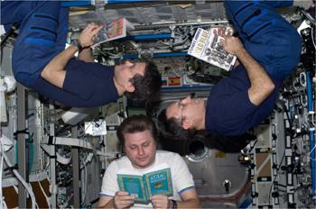 astronaut reading book - photo #28