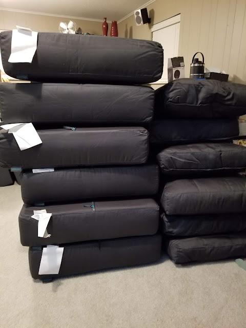 stacks of lovesac sactional sofa cushions
