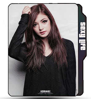 Preview of Crissy Costanza, black dress, against the current band, singer, music.