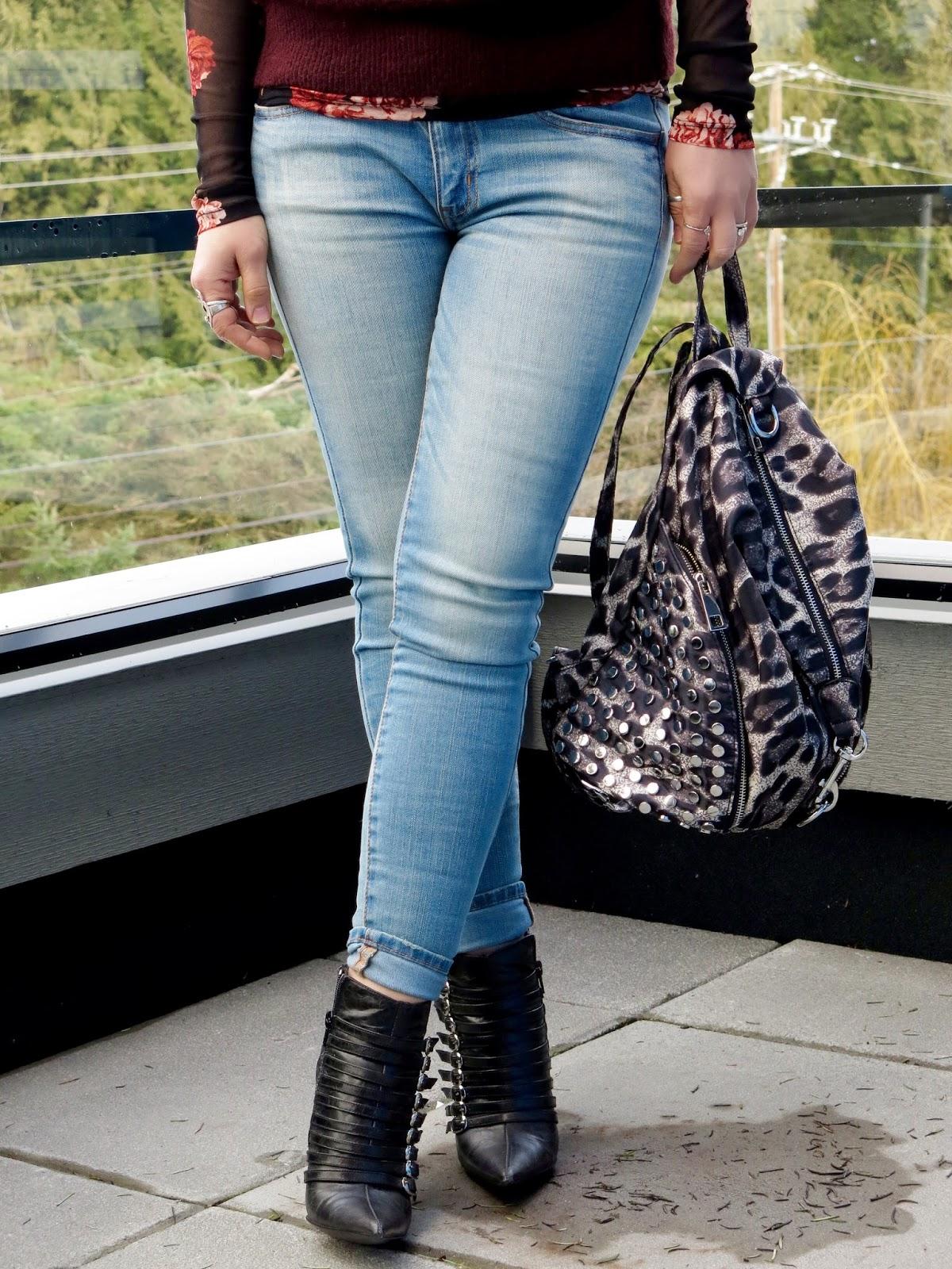 blue denim skinny jeans, stiletto booties, leopard backpack