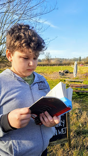 Dan Jon reading at Buckmoorend Farm with Chequers in the background.