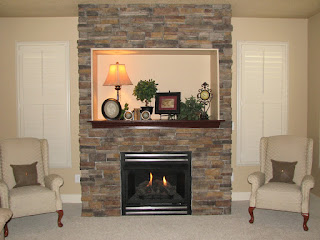 calming cream wall with stoned fireplace design plus armchairs on grey area rug idea