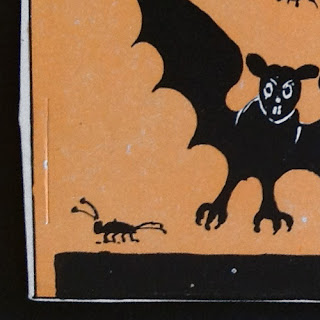 Vintage Beistle diecut with bats and bugs. Front side detail.