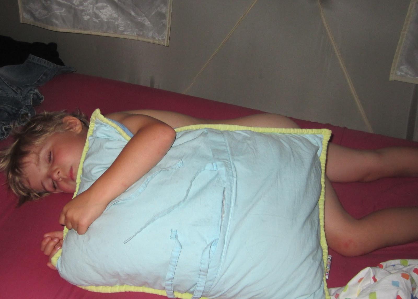 young boy sleeping naked