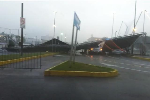http://vnoticia.com.br/noticia/3369-pancada-de-chuva-em-campos-provoca-desabamento-de-estrutura-do-estacionamento-do-shopping-boulevard