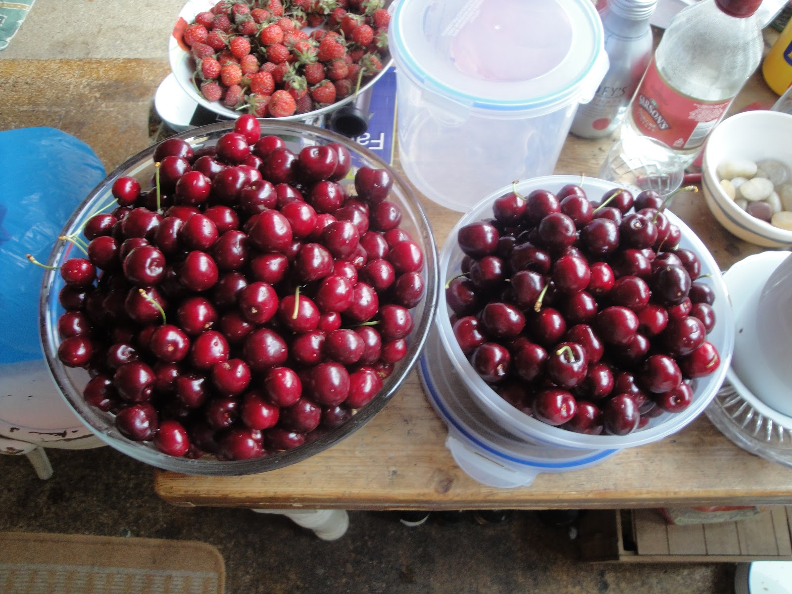 Two large bowls filled to the brim with glistening cherries.
