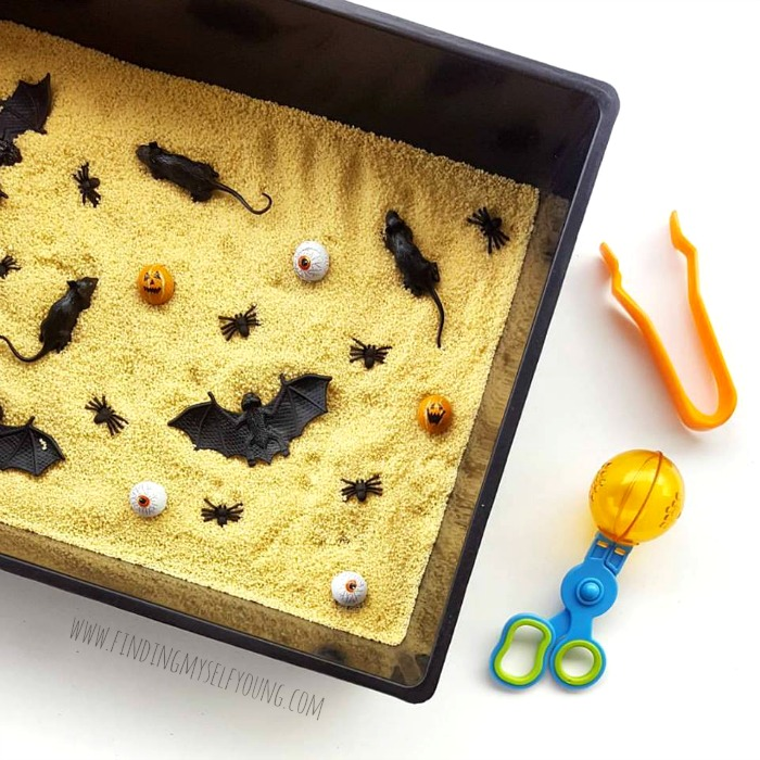 Halloween cous cous and creepy crawly sensory tub for toddlers