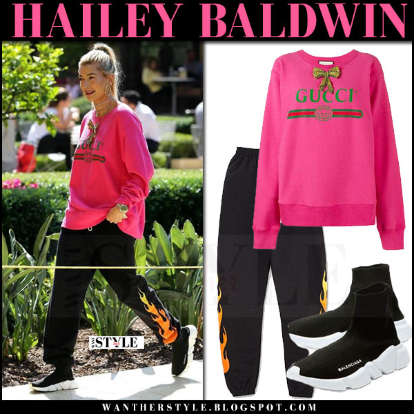Hailey Baldwin in bright pink sweatshirt logo gucci and black sweatpants kylie what she wore june 1 2017