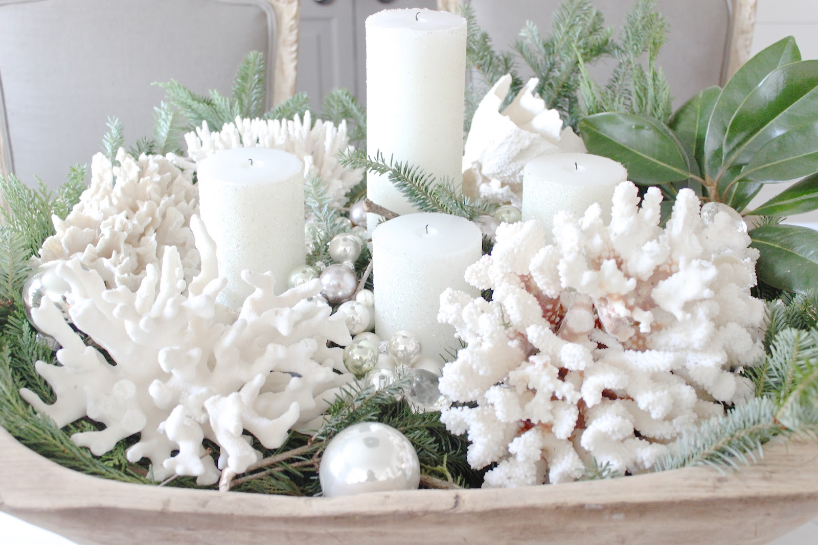Coastal Christmas ingredients in a rustic dough bowl include coral, candles, magnolia leaves and evegreens - Sherry Hart.
