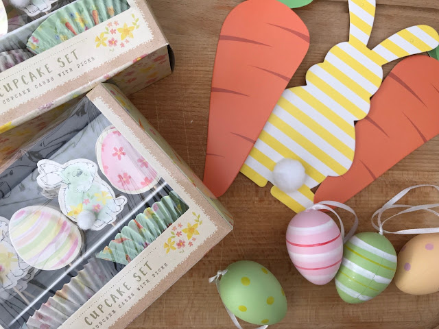Bunny bunting, hanging egg decorations, cupcake cases with toppers