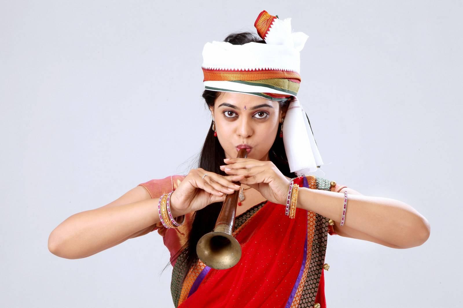 Glamorous Bindu Madhavi Photos In Red half Saree