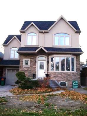 Home Addition Second Storey Was Added Onto A Bungalow And Over The Garage By