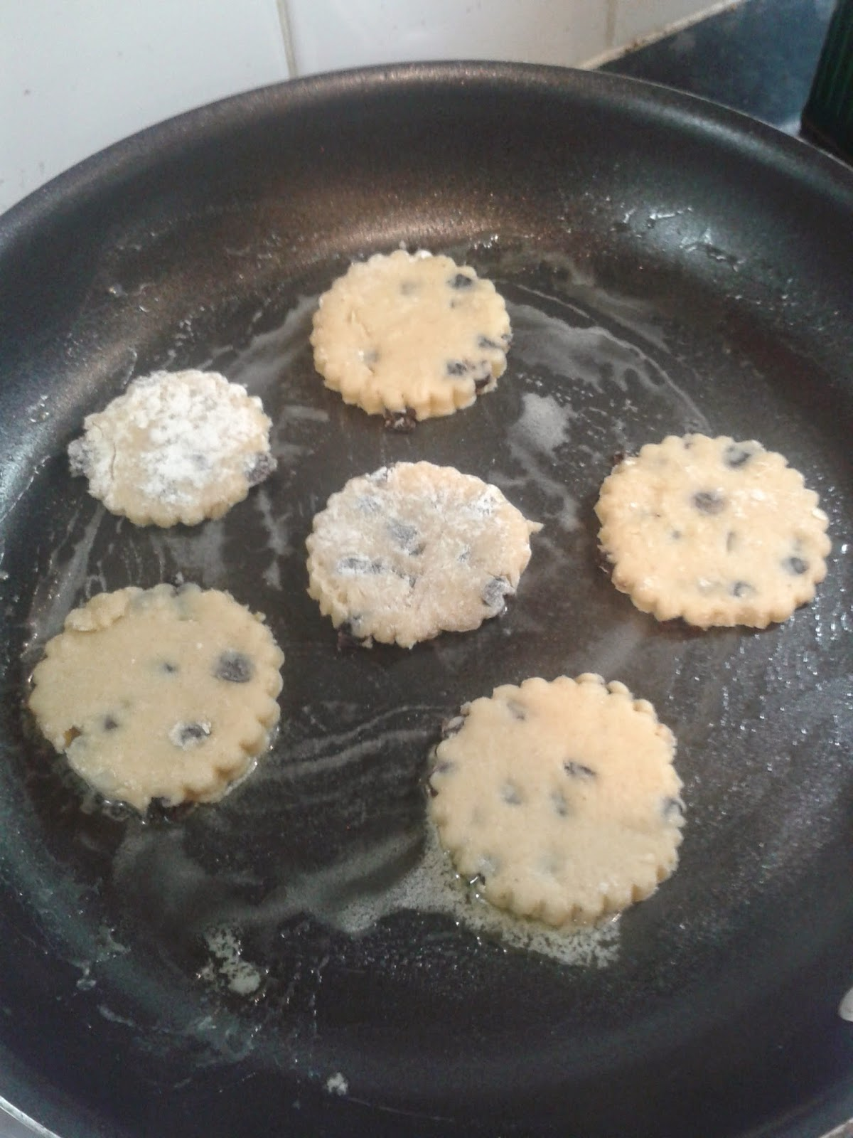 Welsh cakes recipe - Welsh cakes cooking on the hob